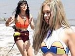Teen stars Nicola Peltz and Maisie Williams model surf clothes on Malibu beach during Teen Vogue photo shoot