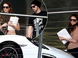 Nice wheels! Ricki-Lee Coulter and her fiance Richard Harrison check out new cars - including a flash $140,000 Porsche