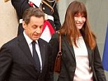 Nicolas Sarkozy and Carla Bruni leave the Elysee Palace on May 15, 2012 in Paris