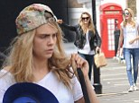 Cara and Poppy Delevingne nail off-duty chic in skinny jeans and trainers as they enjoy a day out together