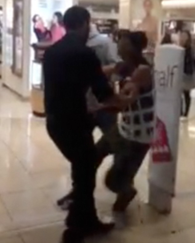 Dragged: The man was pulled back into the Bondi Junction store as he shouted that they were 'hurting' him