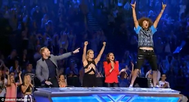 Excited: Redfoo couldn't contain himself and jumped up on the judges desk after Dean performed