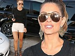 Maria Menounos shows off her toned pins in a pair of tiny white shorts and black high-heel gladiator sandals while dining in West Hollywood