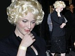 Christina Hendricks ditches signature fiery red locks in favour of a platinum blonde look... but its just a wig for a night out at an LA hotspot