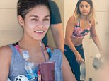 Vanessa Hudgens flashes her flat tummy in tiny crop top as she hits up a gruelling indoor cycling class with sister Stella