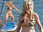 Real Housewives¿ Shannon Beador showcases her bikini body as she goes paddle boarding with husband David during Hawaiian getaway
