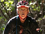 FILE - In this May 2, 2014 file photo, former President George W. Bush leads the second day of a three-day, 100-kilometer mountain bike ride with 16 wounded veterans in Crawford, Texas. Bush has had his left knee partially replaced, seven weeks after having the same procedure on his right knee. (AP Photo/George W. Bush Presidential Center, Paul Morse, File)