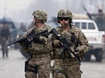 U.S. troops stand guard at the site of a suicide attack in Kabul February 20, 2014. At least one person has killed and four other were wounded in Kabul on Thursday, officials said. REUTERS/Mohammad Ismail (AFGHANISTAN - Tags: POLITICS CIVIL UNREST MILITARY) - RTX195Q3