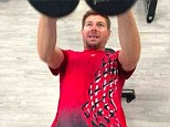 Hit the weights: Steven Gerrard exercises in the gym to prepare for the new season with Liverpool