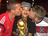 Stuck in the middle with you: Rihanna holds the World Cup while Podolski and Schweinsteiger give her a kiss
