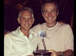 Farewell: Gary Lineker thanks Alan Hansen with a trophy for his years as a pundit for the BBC