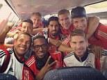 Winners: German stars includig Lukas Podolski and Sami Khedira pose for team selfie