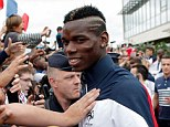 Warm welcome: Midfielder Paul Pogba is mobbed by fans after France's return from the World Cup in Brazil