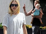 Covering up: Kristen Bell hid her baby bump with a loose striped T-shirt as she met her family at Stamp Proper Foods restaurant in Los Feliz, California on Saturday
