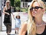 Rachel Zoe reveals her toned arms in summery ensemble as she grabs lunch with son Skyler and husband Rodger Berman