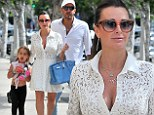 Button up! Kyle Richards shows off ample cleavage in otherwise demure white dress during family outing