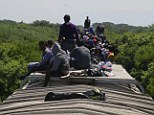 Unaccompanied minors ride atop the wagon of a freight train, known as La Bestia (The Beast) in Ixtepec, in the Mexican state of Oaxaca. A new song widely circulated on Central American radio about the train was created by the U.S. government to subliminally dissuade migrants from crossing the border