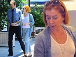 A fresh-faced Alyson Hannigan, 40, goes makeup-free as she shops with husband Alexis Denisof in Los Angeles