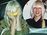 First you Sia her now you don't! Furler goofs around by hiding face in a BANANA while showing off bizarre arm drawings