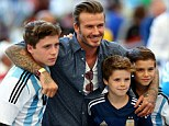 The family that plays together stays together: David with sons Brooklyn, Cruz and Romeo in Rio at the World Cup final
