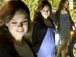 Pregnancy definitely agrees with her! Mila Kunis glows at dinner with friends as she dresses her baby bump in a lilac frock
