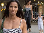 Top Mom! Padma Lakshmi holds her daughter Krishna's hand while dressed in stylish black dress