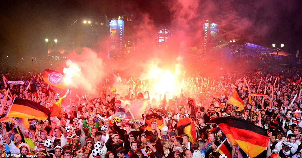 Get the party started! The 200,000 German fans gathered on a 'Fan Mile' near the Brandenburg Gate in Berlin celebrate their team's 1-0 win over Argentina in the World Cup final