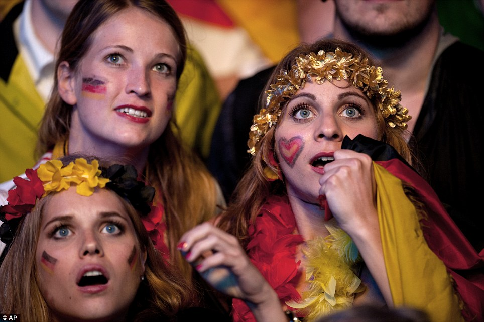 Tension: These Germany fans were engrossed in the action as they watched the final on a big screen in Berlin