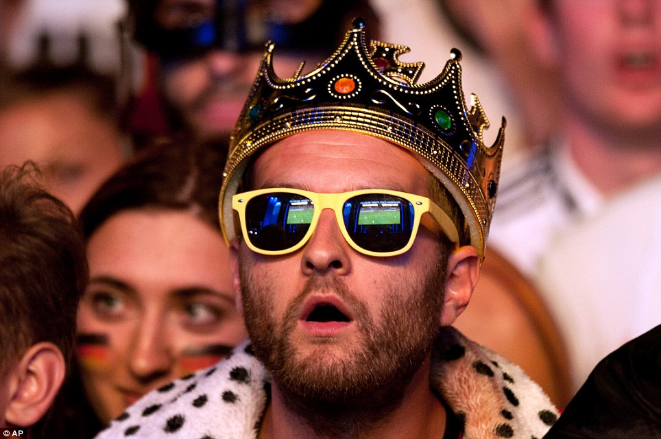 Amazement: This fan, dressed in a crown and sunglasses, was transfixed by the drama
