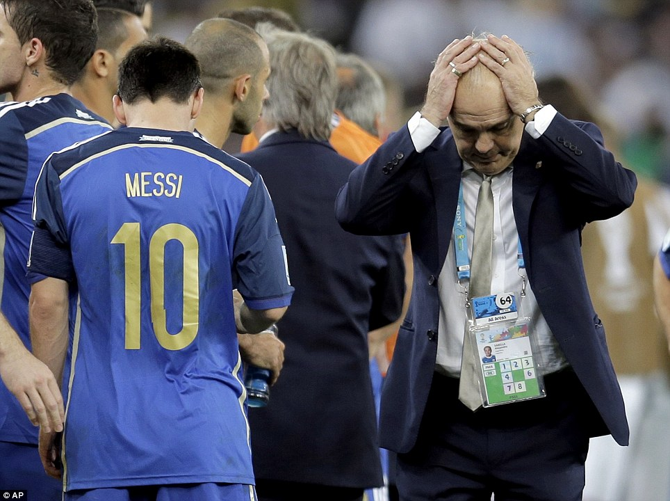 Headache: Argentina coach Alejandro Sabella holds his head next to Lionel Messi during extra time