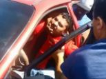 Gotcha: Passers-by haul Ismael Hernandez out the car he is accused of attempting to steal with its owner and her child still inside
