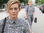Gorgeous in grey: Hilary Duff showed off her shapely figure in grey skinny jeans while shopping at MAC cosmetics in Los Angeles on Monday