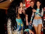Wild! Rihanna puts her enviable figure on display in leopard print crop top