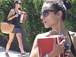 Can?t get enough trainers! Jordana Brewster is dressed for a workout while carrying a box of new sports shoes