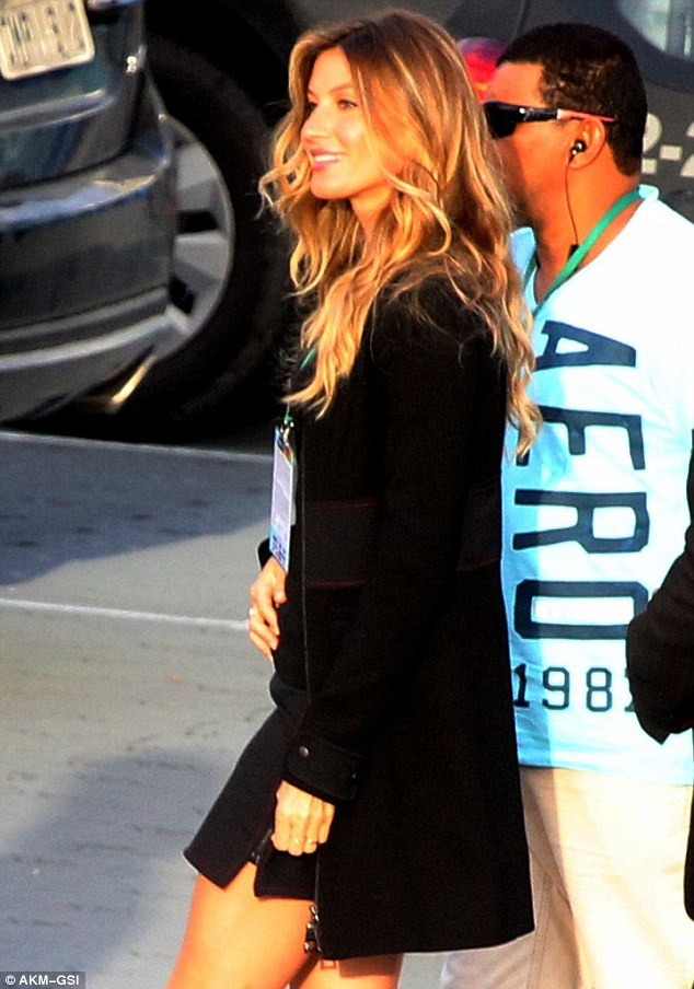 Stunner: She kept warm in a regal black coat, while her hair cascaded down her back in luxurious waves