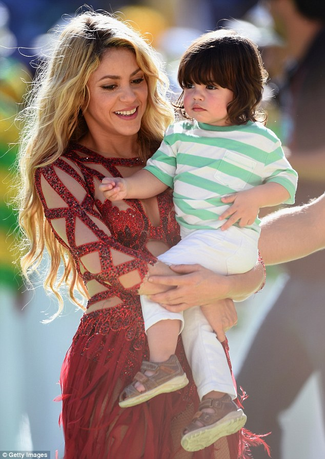 Mommy and me! She was pictured holding her 17-month-old son Milan, whose father is Spanish soccer player Gerard Pique
