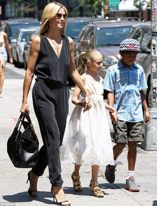 Family fun: Heidi walked with daughter Leni and son Henry to the Broadway show