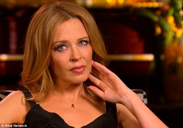 Hard to speak: Kylie Minogue became  upset during the interview with Karl Stefanovic on 60 Minutes, on Sunday night