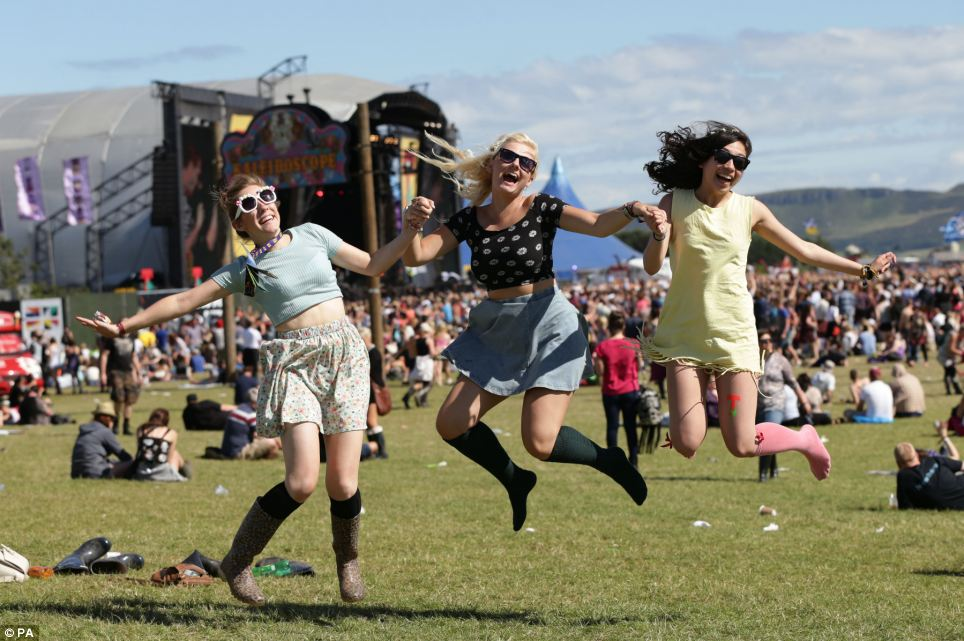 Festival sunshine: Festival goers at the final day of T in the Park at Balado Park in Kinross, Scotland, Hayley Sands, Steph Milne and Becky Macdougall, enjoyed fine and sunny weather