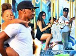 Jamie Foxx piggybacks daughter Annalise, four, around Disneyland... and hits the merry-go-round with her unidentified mother