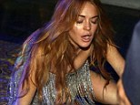 Oh no: Lindsay Lohan took an embarrassing tumble at the Ischia Film Festival on Tuesday