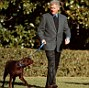 'He had to go to the doghouse ¿ literally': In a new book, journalist Daniel Halper reportedly claims that this December 30, 1998 photo of President Bill Clinton walking his dog Buddy in from the White House while wife Hillary and daughter Chelsea stroll a few feet away was staged. A source told Halper that Hillary was purposefully keeping her distance from Bill to gain sympathy from voters