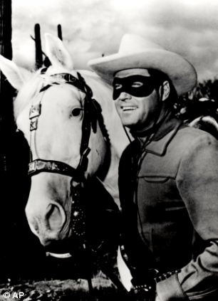 Clayton Moore wears the famous Lone Ranger outfit during the TV show