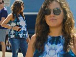 Pregnant Mila Kunis keeps a protective hand on her baby bump as she enjoys Sunday brunch with family