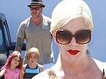 The family that relaxes together... Tori Spelling and Dean McDermott put cheating scandal behind them as they take the kids for massages and pizza