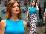 Ashley Greene makes for a dizzying sight in snazzy flares and a tight blue top