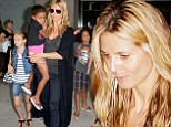 Rainy night: Heidi Klum left her New York apartment on Monday as rain was falling in New York City