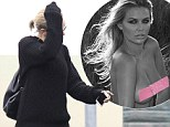 Suddenly camera shy, Lara? Beach babe Bingle covers her face as she dashes out of the gym after posing topless on Instagram