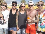 McBusted stag do: Shirltess Danny Jones looked to be having a whale of a time at Ocean Beach Ibiza with Dougie Poynter (centre), Matt Willis (second left), Harry Judd, James Bourne (left) and Tom Fletcher (right)