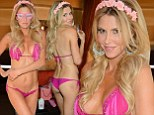 Unreal housewife! Brandi Glanville, 41, turns up the heat at a Las Vegas pool party in a tiny pink bikini